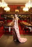 Bride in unusual wedding dress in restaurant Stock Photo
