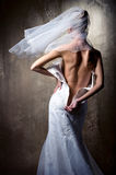Bride unzip her wedding dress Stock Photography