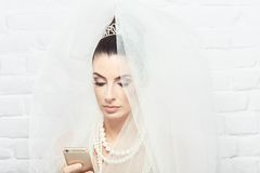 Bride using mobilephone Royalty Free Stock Image