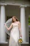 Bride with veil blowing Royalty Free Stock Images