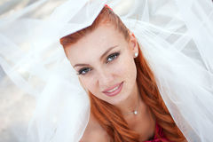 Bride in veil close up outside Royalty Free Stock Photography