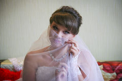 Bride veil covers her face. Bride with a gentle makeup covers the face veil. Photo taken in 2013 Stock Photo
