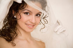 Bride with the veil in her hand Royalty Free Stock Image
