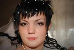 Bride in veil before the wedding. Brunette in a crown with pearl royalty free stock photos