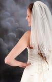 Bride in veiled wedding dress Royalty Free Stock Photo