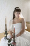 Bride with a vintage candles Stock Photography