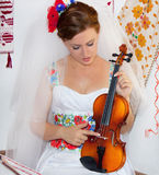 Bride with violain Stock Photography