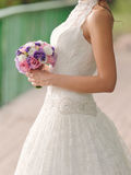 Bride with Violet Bouquet Royalty Free Stock Image