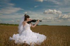 Bride & violin Royalty Free Stock Images