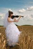 Bride & violin Royalty Free Stock Images