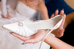Bride wait a shoe Stock Photos