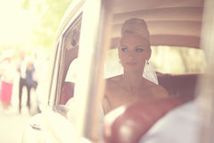Bride waiting in the car Royalty Free Stock Images