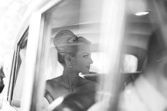 Bride waiting in the car Royalty Free Stock Photography