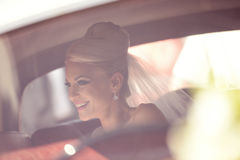 Bride waiting in the car Stock Images
