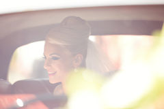 Bride waiting in the car Royalty Free Stock Photo