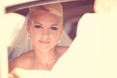 Bride waiting in the car Stock Photo