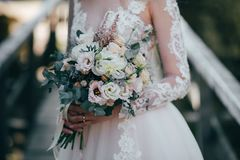 Wedding bouquet in bride`s hands. The bride is waiting for the groom. Wedding bouquet in bride`s hands Royalty Free Stock Photo