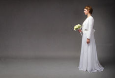 Bride waiting while standing stock photography