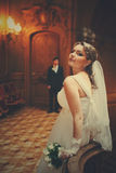 Bride waits for a groom in the hall of old theatre Stock Photo
