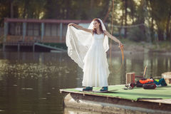 Bride on a wakeboard on the lake. Royalty Free Stock Images