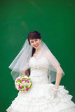 Bride by the  wal Stock Photography