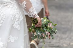 Bride walk with groom on street royalty free stock images