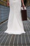 Bride walking on the bridge Royalty Free Stock Photography