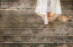 Bride walking down stairs in wedding dress Royalty Free Stock Photos