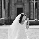 Bride walking next to old church Royalty Free Stock Image