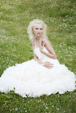 Bride walking in the park. Beautiful bride with white hair walking in the park Stock Photo