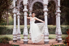 Bride walking in the park. Photo of bride walking in the park Stock Photos