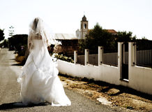 Bride walking to church. Bride walking alone to church Stock Image