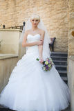 Bride walking on the wedding day. Blonde bride posing on the photos on the wedding day Royalty Free Stock Photos