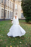 Bride walking on the wedding day. Blonde bride posing on the photos on the wedding day Royalty Free Stock Images