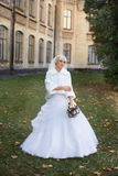 Bride walking on the wedding day. Blonde bride posing on the photos on the wedding day Stock Photos