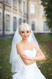 Bride walking on the wedding day. Blonde bride posing on the photos on the wedding day Stock Images