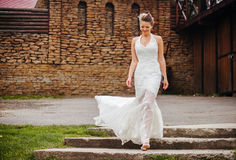 Bride walks down the stairs Royalty Free Stock Images