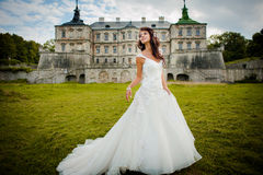 Bride walks next to castle Stock Photography