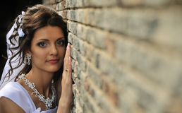 The bride at a wall Royalty Free Stock Image