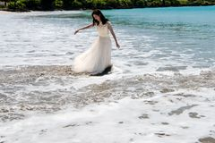 Oops! Unexpected wave makes bridal dress of bride wet and dirty