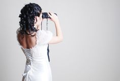 Bride watching in binocular Royalty Free Stock Photo