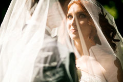 Bride is watching on her beloved Stock Photo