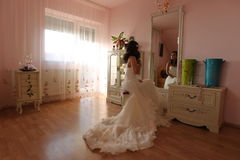 Bride watching in the mirror preparing for her wedding Royalty Free Stock Photography