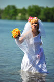 The bride in water Royalty Free Stock Photo