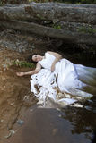 Bride in water. Bride lies in water, dirt, may be dead or depressed stock photography