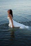Bride in water. A bride getting bridal gown wet Stock Photo
