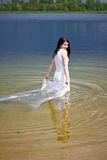 Bride in the water Royalty Free Stock Photos
