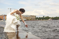 Bride on the waterfront Stock Image