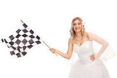 Bride waving a checkered race flag Royalty Free Stock Photo