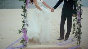 Bride is Waving Dress Holds Hand of Groom stock video footage